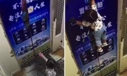 Vídeo: Menina presa em elevador fica pendurada por guia de segurança